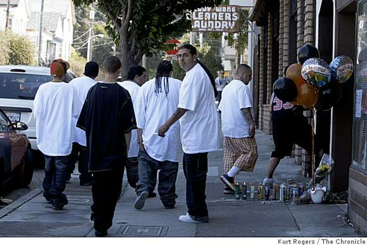 A group of young men gather on Friday, Sept, 5 2008 in San Francisco, Calif., near 24th and Utah streets where Noel Espinoza and Matthew Solomon where killed on Thursday evening, Sept. 4, 2008.