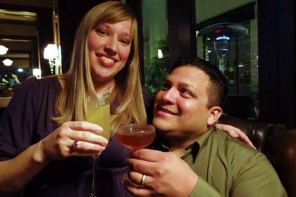 Daniel and Amanda Espinoza enjoy a drink at Bohanon's on Wednesday, Feb. 8, 2012. They were engaged at Bohanon's in 2003, when Daniel asked Amanda to marry him over dessert. Billy Calzada / San Antonio Express-News