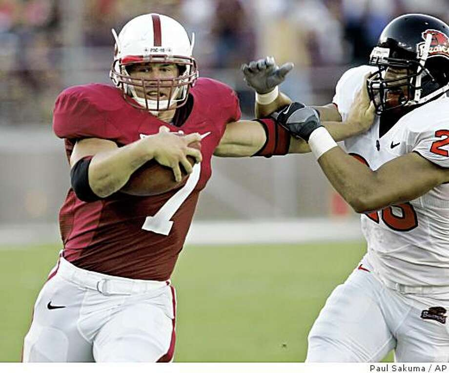 Stanford running back Toby Gerhart (7) gains 29 yards in front of Oregon State safety Suaesi Tuimaunei (28) in the second quarter of their NCAA football game in Stanford, Calif., Thursday, Aug. 28, 2008. (AP Photo/Paul Sakuma) Photo: Paul Sakuma, AP