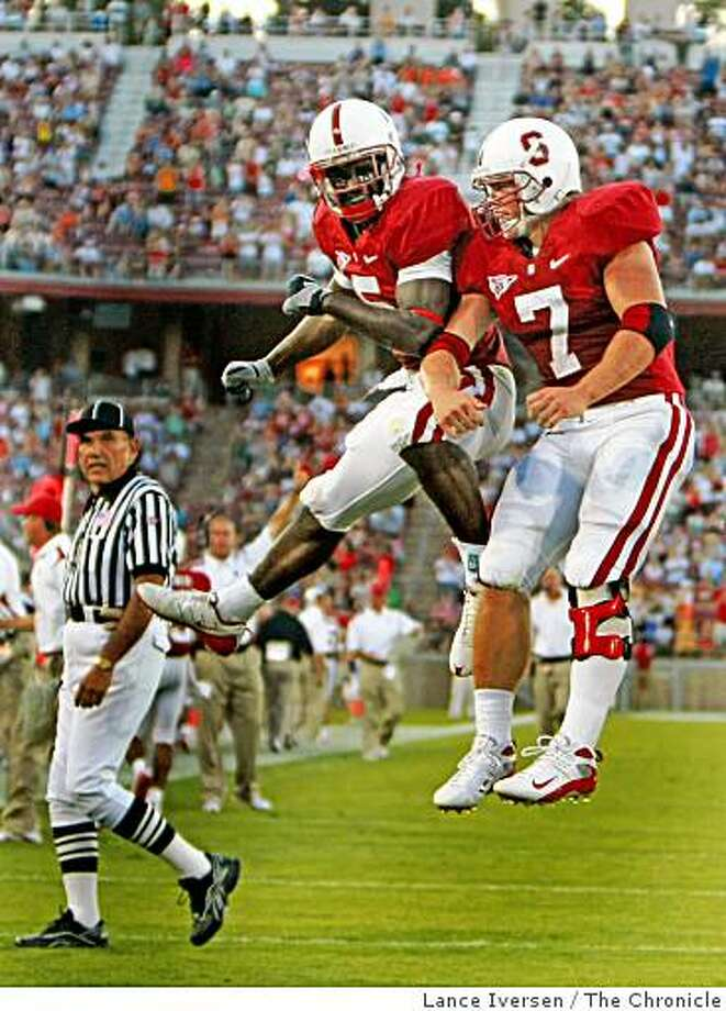 Stanford University Anthony Kimble and Toby Gerhart right celebrate Gerhart's second TD of the night as Stanford played the Oregon State Beavers in their first conference game of the season Thursday, Aug. 28, 2008. The score is 17-17 at the half. Photographed in Palo Alto. Photo: Lance Iversen, The Chronicle