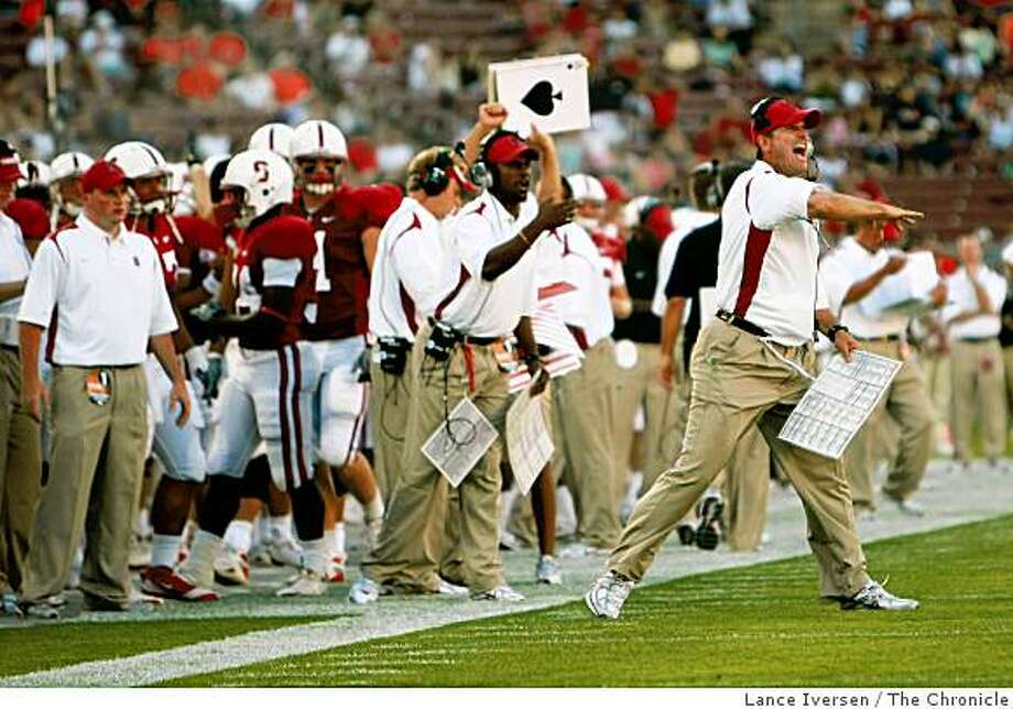 Stanford University head coach Jim Harbaugh calls out a play as the Cardinal was first and goal late into the 2nd quarter during their game with Oregon State Beavers Thursday, Aug. 28, 2008. The score is 17-17 at the half. Photographed in Palo Alto. Photo: Lance Iversen, The Chronicle