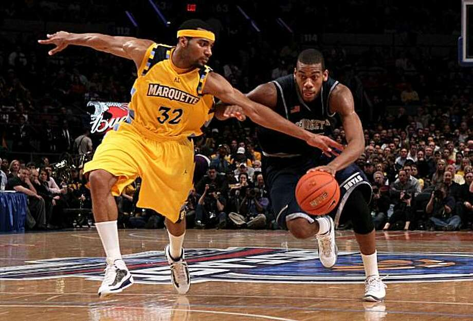 NEW YORK - MARCH 12: Greg Monroe #10 of the Georgetown Hoyas dribbles the ball as Lazar Hayward #32 of the Marquette Golden Eagles reaches in during the semifinal of the 2010 Big East Tournament at Madison Square Garden on March 12, 2010 in New York City. Photo: Jim McIsaac, Getty Images