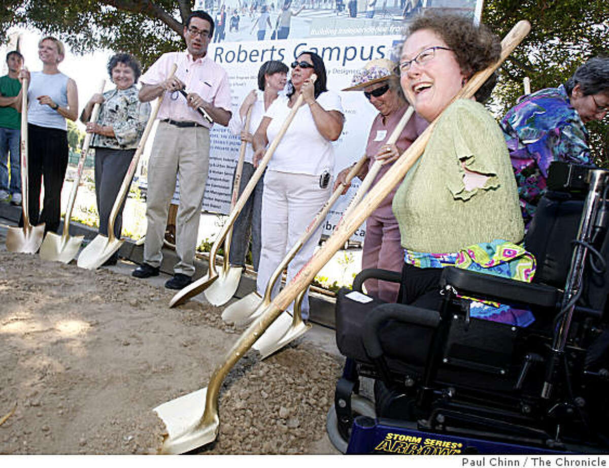 Jan Garrett (right), vice president of the Ed Roberts Campus, joined other dignitaries in the groundbreaking ceremony for the Ed Roberts Campus at the Ashby BART station in Berkeley, Calif., on Thursday, Sept. 4, 2008.