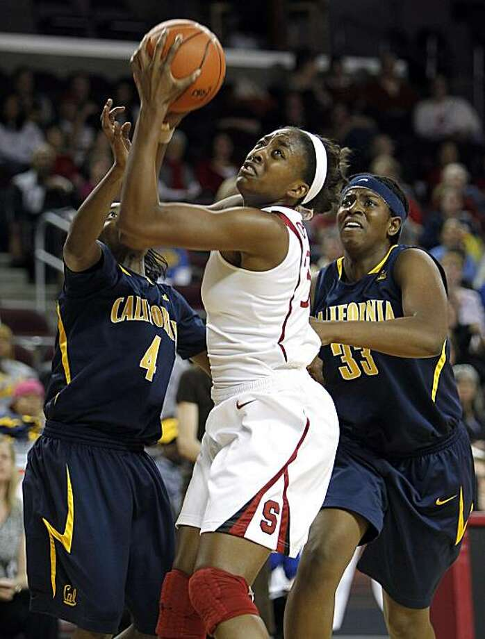 Stanford forward Nnemkadi Ogwumike, center, pulls up for a shot against California guard Eliza Pierre, left, and center Talia Caldwell in the first half of an NCAA college basketball game in the Pac-10 women's tournament in Los Angeles, Saturday, March 13, 2010. Photo: Alex Gallardo, AP