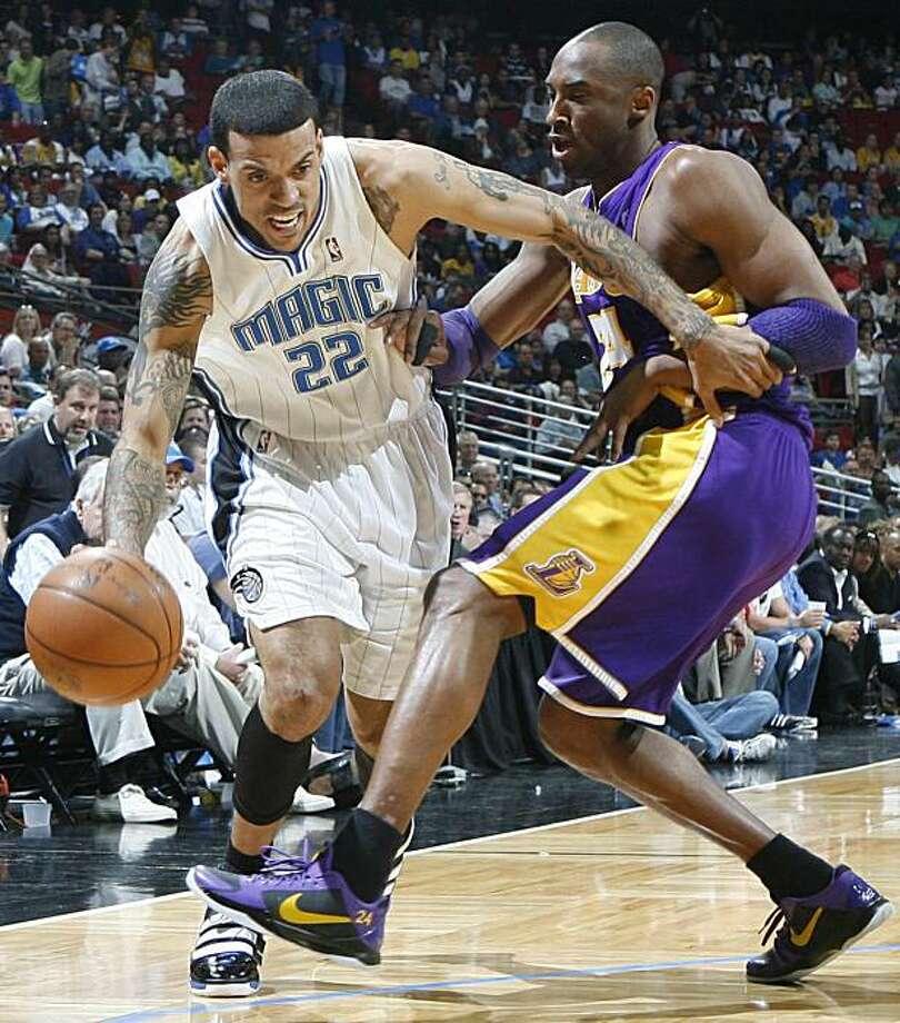 Los Angeles Lakers guard Kobe Bryant (24) fouls Orlando Magic forward Matt Barnes (22) during tan NBA game at Amway Arena in Orlando, FL Sunday, March 7, 2010. The Magic won 96-94. (Gary W. Green/Orlando Sentinel/MCT) Photo: Gary W. Green, MCT