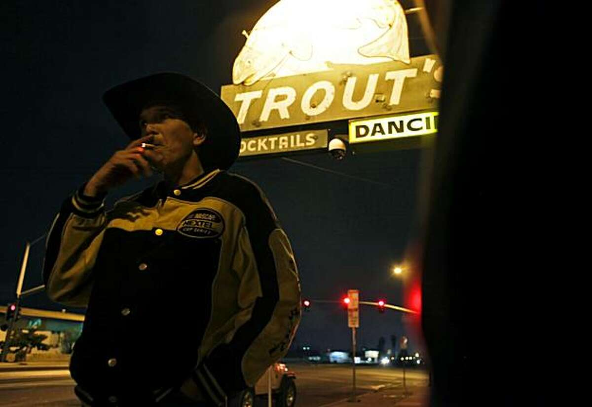 """Vince Edwards enjoys a smoke outside Trout's, a cowboy bar in Bakersfield, on Monday March 8, 2010, the day state Sen. Roy Ashburn announced that he is gay. Edwards, who admitted being uncomfortable around gays, said, """"You won't see alot of rednecks around here backing a gay politician."""""""