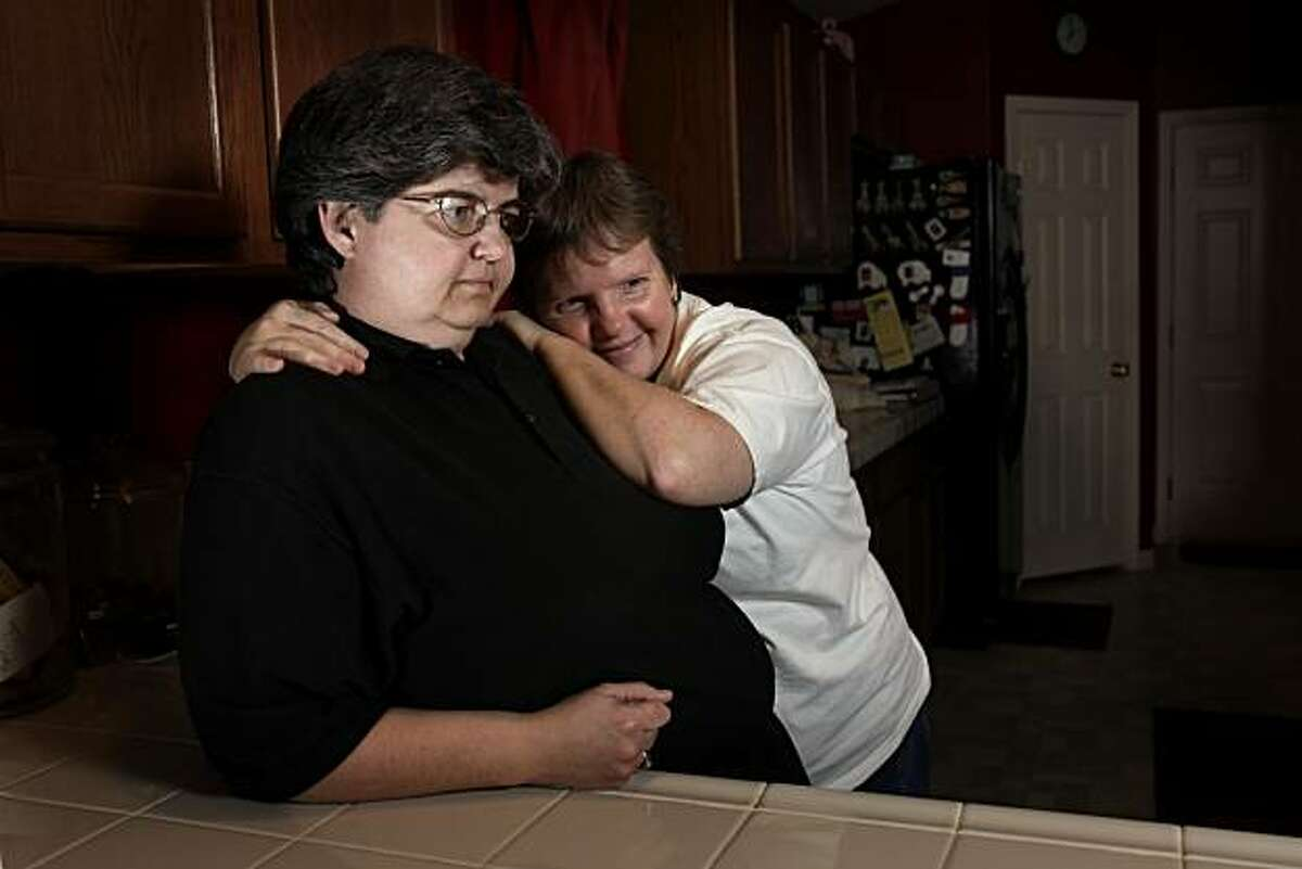 Whitney Weddell, left, cuddles with wife Lori Renee at their home, Monday, March 8, 2010, in Bakersfield, Calif. Having lived in state Sen. Roy Ashburn's district for several years and dealing with his conservative views, they hope he doesn't have problems with the homophobic attitudes in his district.