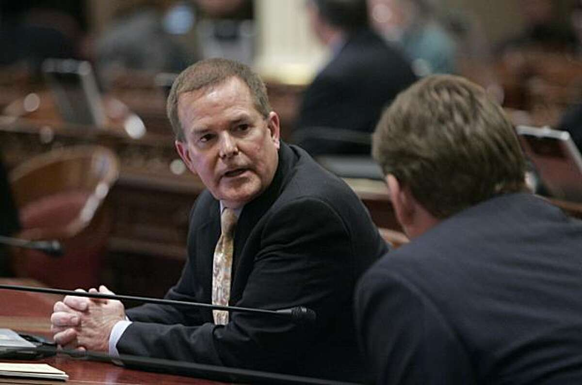 State Sen. Roy Ashburn, R-Bakersfield, left, who had announced earlier in the day that he was gay, talks with Sen. Tony Strickland, R-Thousand Oaks, right, at the capitol in Sacramento, Calif. on Monday, March 8, 2010. Ashburn, 55, who has served in the state Legislature for 14 years, ended days of speculation about his sexual preference that began after his arrest last week on suspicion of driving under the influence.