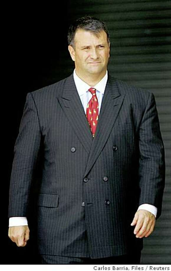 Former Washington lobbyist Jack Abramoff leaves the courthouse in Miami in this August 18, 2005 file photo. A U.S. congressional committee found that Abramoff had more contacts with top White House officials than Bush administration officials had previously acknowledged, a senior congressional aide said on September 28, 2006.REUTERS/Carlos Barria/Files (UNITED STATES) Photo: Carlos Barria, Files, Reuters