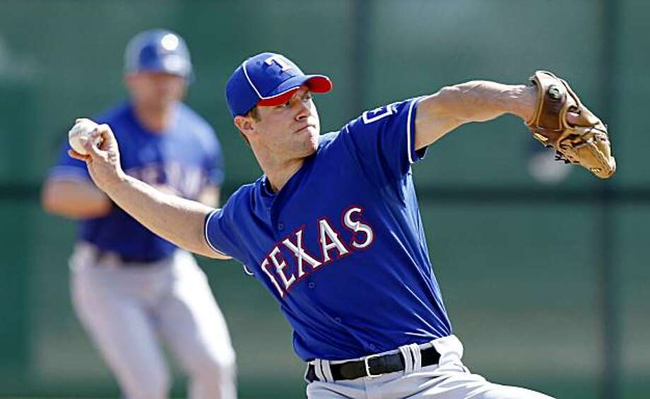 Texas Rangers starting pitcher Rich Harden throws during a baseball spring training practice game Monday, March 1, 2010, in Surprise, Ariz. Photo: Charlie Neibergall, AP