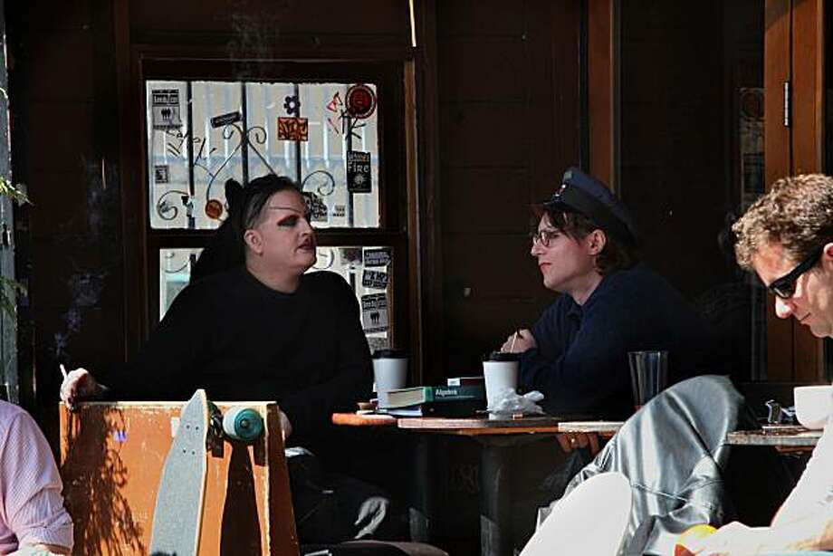 China Hassan (left) and Devin Hassan (right) having coffee and a cigarette at the Revolution, an outdoor club and cafe in the mission  in San Francisco, Ca., on Tuesday, March 9, 2010.  The San Francisco Board of Supervisors is set to approve a plan that would extend smoking bans to smoking outside in public spaces. Photo: Liz Hafalia, The Chronicle