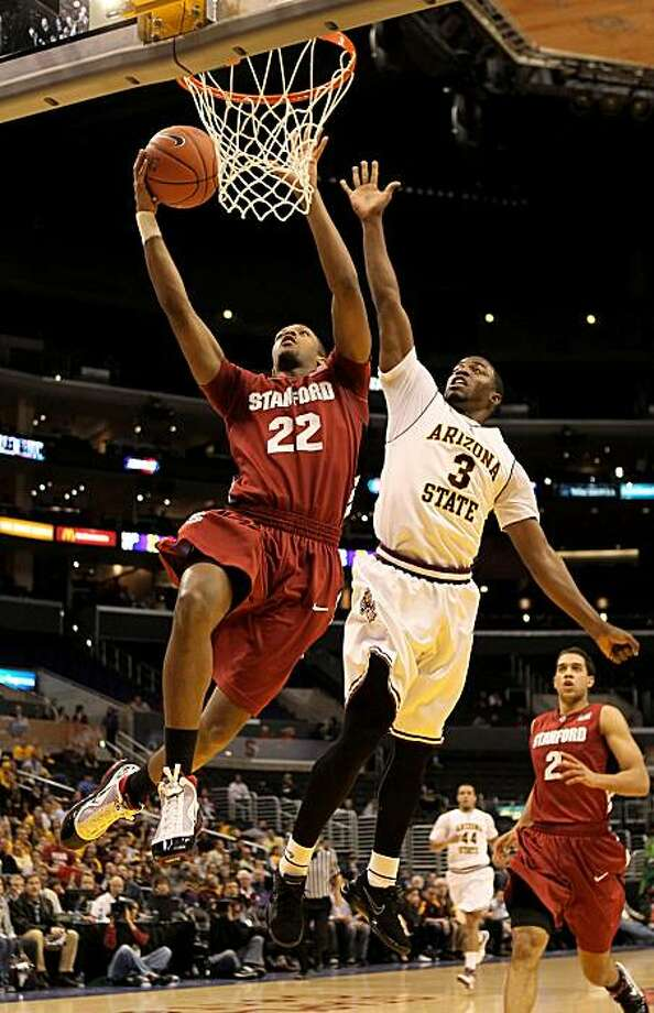 LOS ANGELES, CA - MARCH 11: Jarrett Mann #22 of the Stanford Cardinal  goes up for a shot against Ty Abbott #3 of the Arizona State Sun Devils during the quarterfinals of the Pac-10 Basketball Tournament at Staples Center on March 11, 2010 in Los Angeles,California. Photo: Stephen Dunn, Getty Images