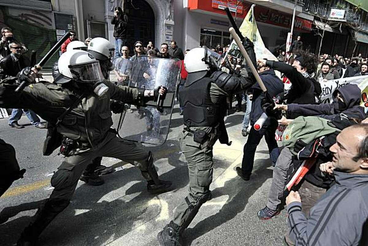 Riot police clash with demonstrators in Athens on March 11, 2010 during a 24-hour general strike to protest the government's austerity plan to solve country's debt crisis. Violence erupted on the sidelines of a large demonstration in the capital with riotpolice firing tear gas at hooded youths hurling firebombs and vandalising stores near the parliament district. he Greek economy, which is mired in a recession, ran into more trouble on Tuesday when the national statistics agency reported the annual inflation rate jumped to 2.8 percent in February.