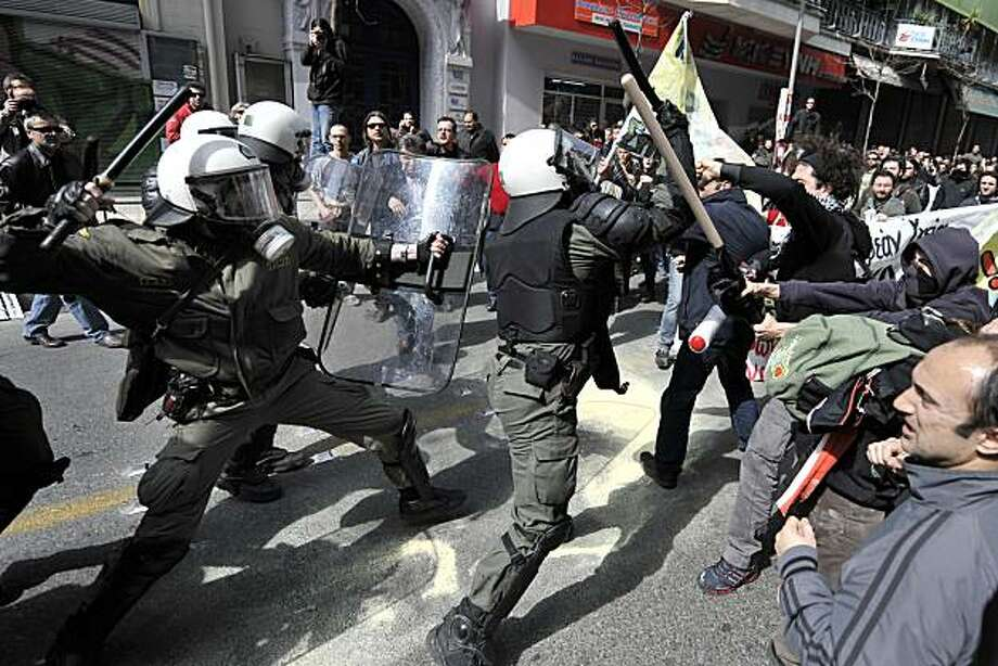 Riot police clash with demonstrators in Athens on March 11, 2010 during a 24-hour general strike to protest the government's austerity plan to solve country's debt crisis. Violence erupted on the sidelines of a large demonstration in the capital with riotpolice firing tear gas at hooded youths hurling firebombs and vandalising stores near the parliament district. he Greek economy, which is mired in a recession, ran into more trouble on Tuesday when the national statistics agency reported the annual inflation rate jumped to 2.8 percent in February. Photo: Aris Messinis, AFP/Getty Images