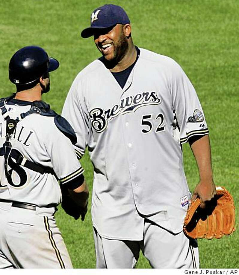 Milwaukee Brewers pitcher CC Sabathia (52) celebrates with catcher Jason Kendall after throwing a complete game one-hitter against the Pittsburgh Pirates in a baseball game in Pittsburgh Sunday, Aug. 31, 2008. The Brewers won 7-0. (AP Photo/Gene J. Puskar) Photo: Gene J. Puskar, AP