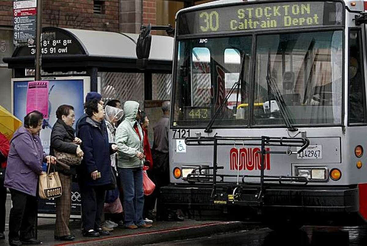 A Muni bus stops to pick up passengers along Stockton Street near Broadway on Friday.
