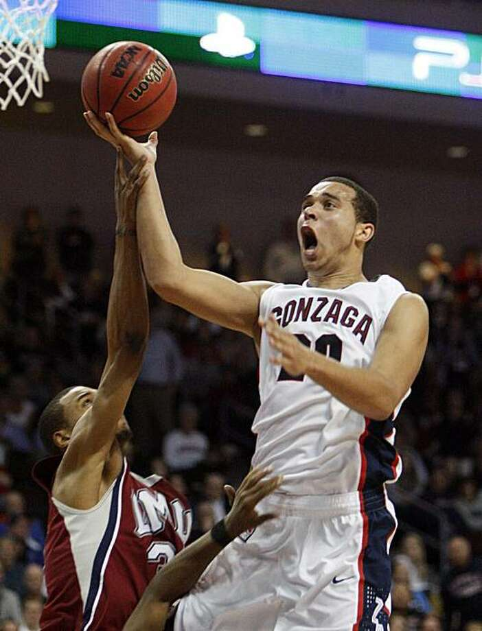 Gonzaga's Elias Harris, right, is fouled by Loyola Marymount's Larry Davis during the second half of an NCAA college basketball game at the West Coast Conference championships Sunday, March 7, 2010 in Las Vegas. Photo: Isaac Brekken, AP