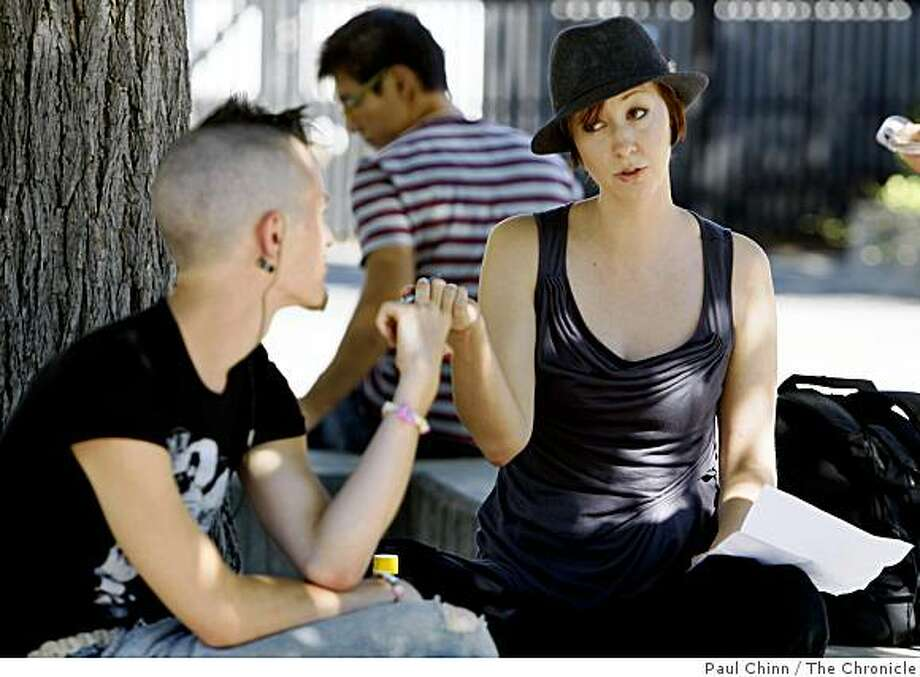 Nova Robb, right, talks with her friend Seth Zimmerman on the Diablo Valley College campus in Pleasant Hill, Calif., on Wednesday, Sept. 3, 2008. Robb, a single mother and full-time student, fears she'll have to drop out of school if her Cal Grant financial aid package is withheld because of the state budget impasse. Photo: Paul Chinn, The Chronicle