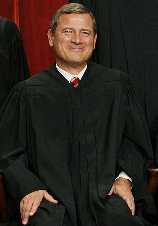 FILE - In this Sept. 29, 2009, file photo, Chief Justice John Roberts sits for a new group photograph with other Supreme Court judges at the Supreme Court in Washington. For a short time Thursday, March 4, 2010, Washington buzzed over a rumor reported exclusively by an online gossip Web site with no particular Supreme Court expertise that Chief Justice John Roberts was considering stepping down. He is not resigning, as even the Radar Online site quickly concluded in backing away from its own story. Photo: Charles Dharapak, AP
