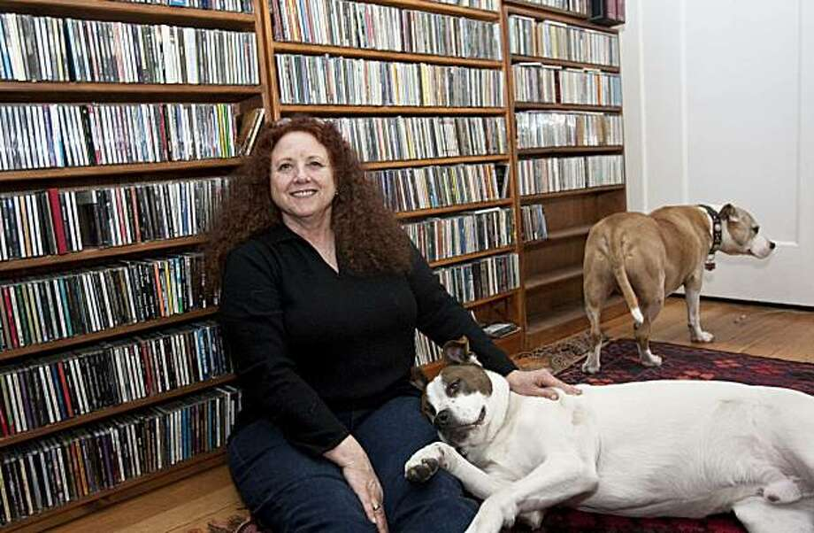 Disc Jockey Bonnie Simmons with her large collection of CDs and her two dogs at her home in Oakland, Calif., on Friday, February 19, 2009. Photo: Laura Morton, Special To The Chronicle