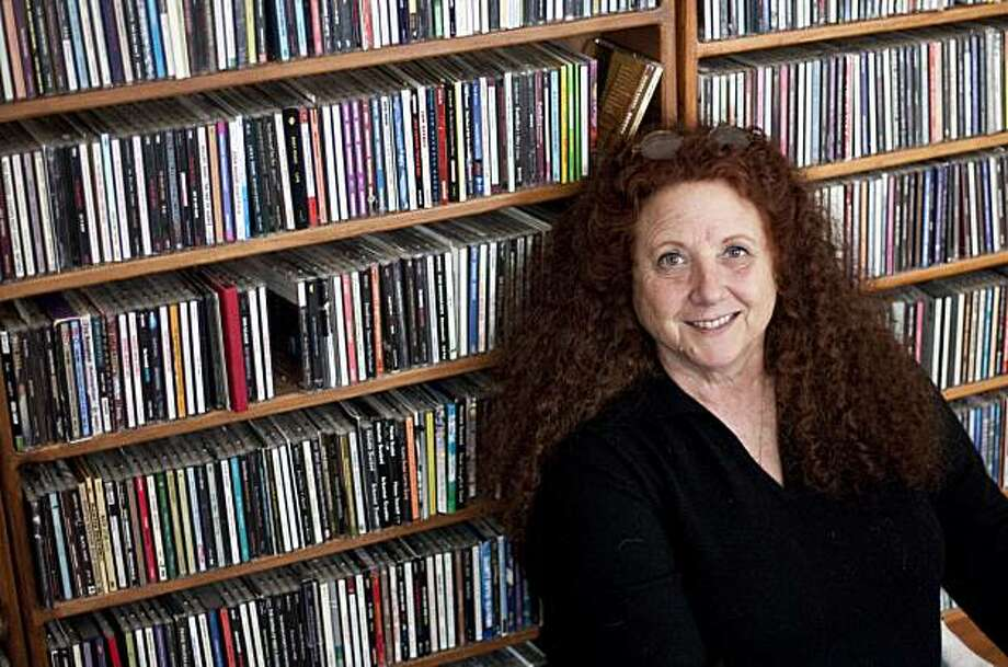 Disc Jockey Bonnie Simmons with her large collection of CDs at her home in Oakland, Calif., on Friday, February 19, 2009. Photo: Laura Morton, Special To The Chronicle