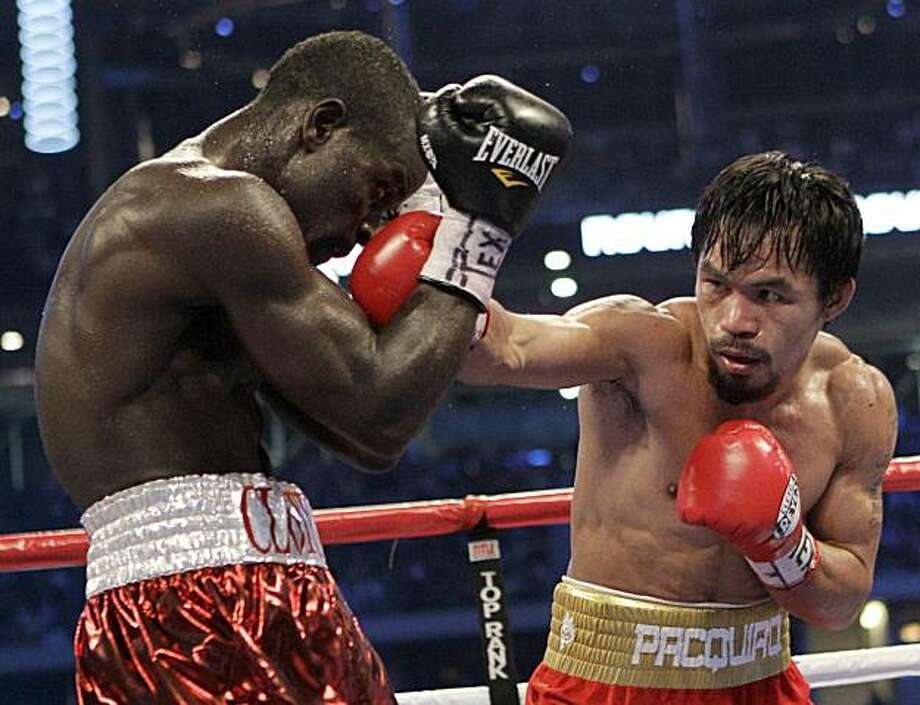 Manny Pacquiao, right, of the Philippines, hits Joshua Clottey, from Ghana, during their WBO boxing welterweight title fight in Cowboys Stadium in Arlington, Texas, Saturday, March 13, 2010. Photo: David J. Phillip, AP