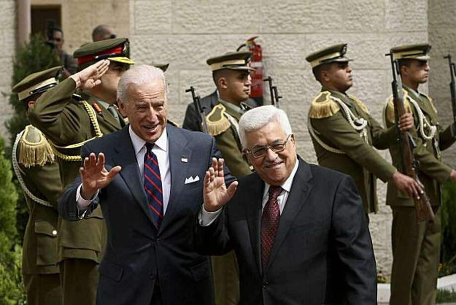 U.S. Vice President Joseph Biden, left, and Palestinian President Mahmoud Abbas wave to the press ahead of their meeting in the West Bank city of Ramallah, Wednesday, March 10, 2010. Israel's new plan to build 1,600 homes for Jews in Palestinian-claimed east Jerusalem overshadowed Vice President Joe Biden's visit to the West Bank on Wednesday. Biden was to hold talks with Palestinian President Mahmoud Abbas and Prime Minister Salam Fayyad, in part to ease their doubts about the latest U.S. peace efforts. Photo: Tara Todras-Whitehill, AP