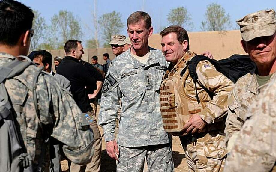 FILE - In this Monday March 1, 2010  file photo, the head of NATO in Afghanistan, U.S. General Stanley McChrystal, center left, poses for a photograph with an unidentified British soldier during a visit by Afghan and NATO officials in the city of Marjah,Helmand province  The offensive on the southern Afghan town _ NATO's largest combined operation in Afghanistan _ is described as the first step of an 18-month push to push the Taliban out for good. Photo: Massoud Hossaini, AP