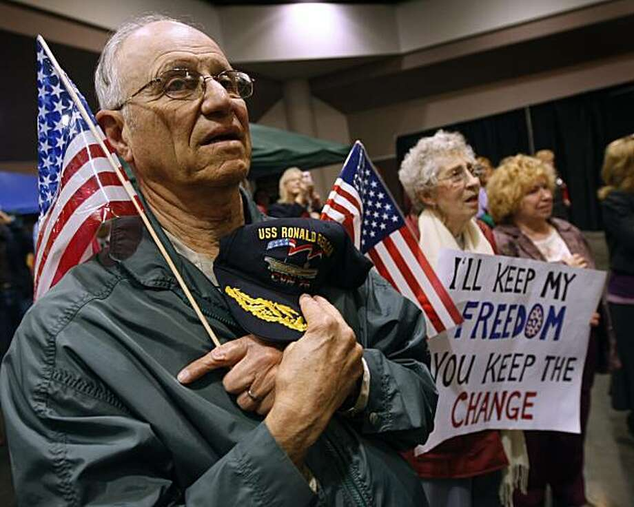 Bill Hughes, of San Jose, removes his cap for the National Anthem during a Tea Party rally at the California Republican Party Convention in Santa Clara, Calif., on Saturday, March 13, 2010. Hughes' wife Geri hold a rally sign (right). Photo: Paul Chinn, The Chronicle