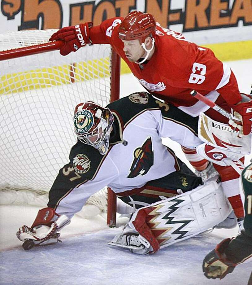 Minnesota Wild goalie Josh Harding (37) is unable to stop the shot by Detroit Red Wings center Johan Franzen (93), of Sweden, for a score during the third period of an NHL hockey game, Thursday, March 11, 2010 in Detroit. The Red Wings defeated the Wild 5-1. Photo: Carlos Osorio, AP