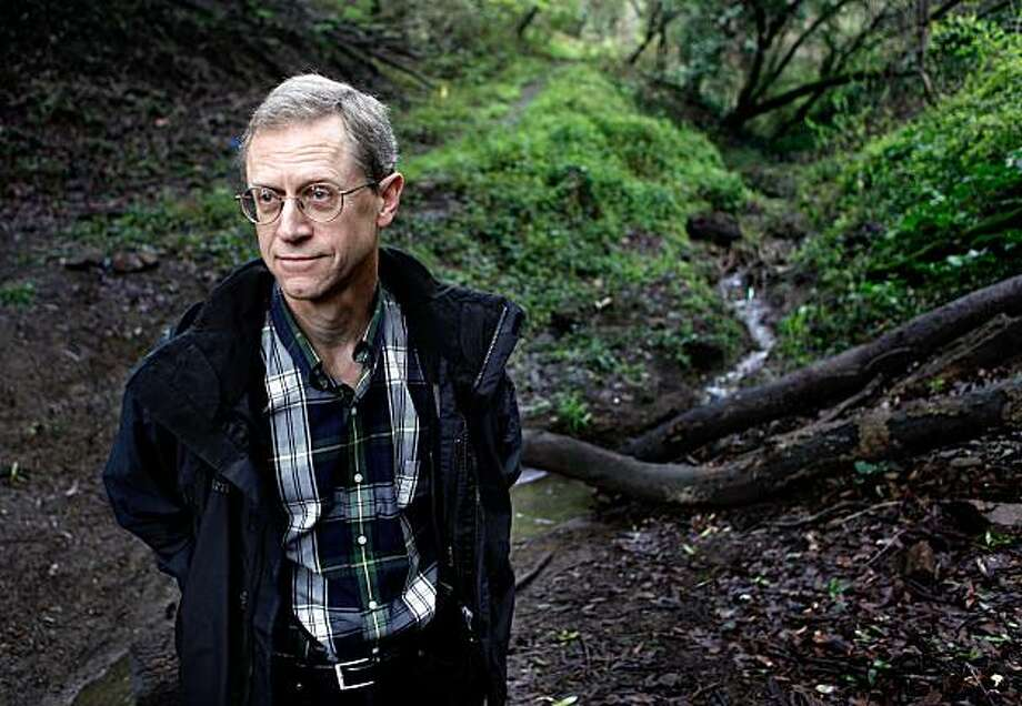David Barron, is the president and director of the Butters Canyon Conservancy, in Oakland, Calif. on Tuesday Mar. 2, 2010, with Peralta Creek trickling by. The City of Oakland has managed to scrape together enough money to save the Oakland Hills Canyon from development. Photo: Michael Macor, The Chronicle