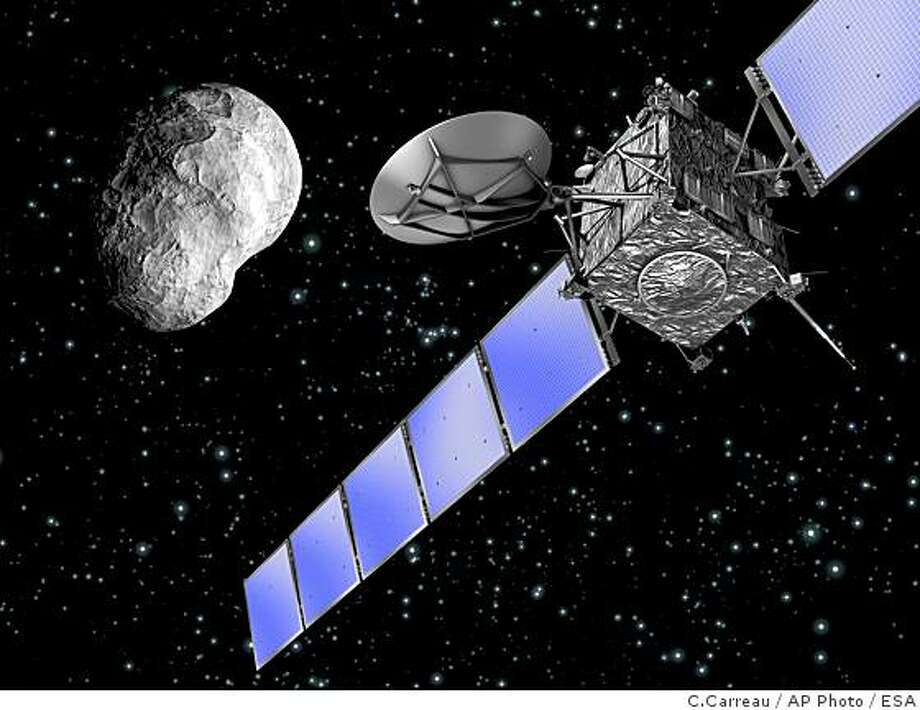 An European Space Agency image taken from the ESA's webside on Friday, Sept 5. 2008 shows an artist's impression of ESAs Rosetta spacecraft flying by asteroid (2867) Steins on Sept. 5, 2008 at 20:58 CEST (1858 GMT), with a closest approach distance of 800 kilometers. Steins is Rosettas first nominal scientific target. The spacecraft encountered the asteroid in the course of its first incursion into the main asteroid belt located between the orbits of Mars and Jupiter, while on its way to Comet 67P/Churyumov-Gerasimenko, which is scheduled for 2014. Photo: C.Carreau, AP Photo / ESA