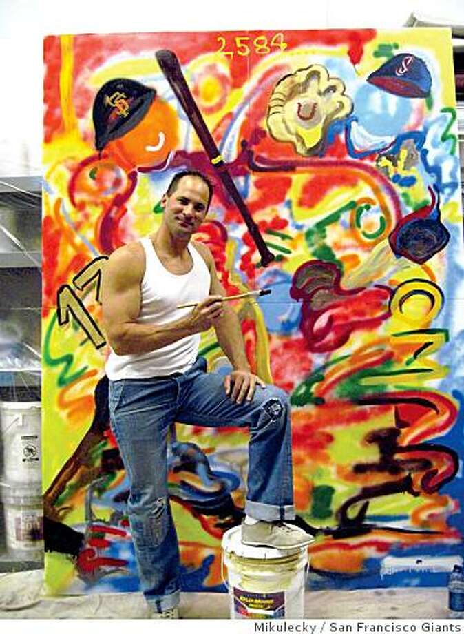 "Giants shortstop Omar Vizquel with his mixed media painting, ""My Big League Career'.' Photo: Mikulecky, San Francisco Giants"