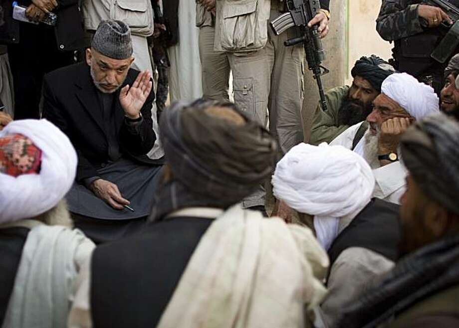 Afghan President Hamid Karzai talks to locals in Marjah, Afghanistan, Sunday, March 7, 2010. Afghan President Hamid Karzai heard a litany of complaints Sunday from residents of Marjah, the town in the south that thousands of U.S., NATO and Afghan troops just seized from the Taliban. Photo: Dusan Vranic, AP