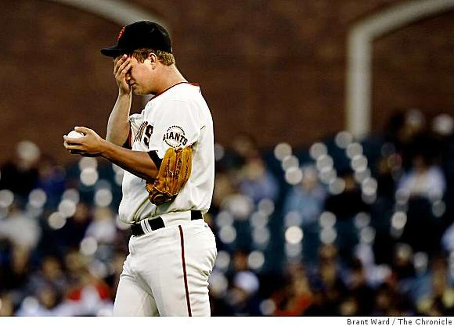 Matt Cain looks pained after giving up a 2 run homer to Yorvit Torrealba in the second inning. San Francisco Giants action against Colorado Rockies at AT&T park Monday August 25, 2008. Photo: Brant Ward, The Chronicle