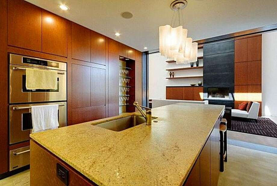 The gourmet kitchen with a built-in espresso machine, wine cellar, wet bar and butler's pantry. Photo: Dan Friedman