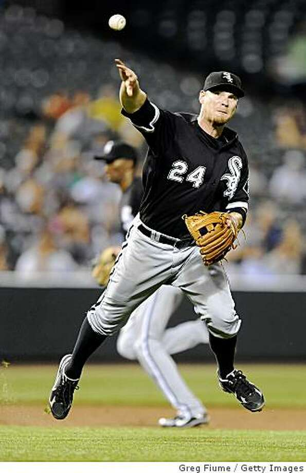 BALTIMORE - AUGUST 25:  Joe Crede #24 of the Chicago White Sox throws the ball to first base during the game against the Baltimore Orioles at Camden Yards August 25, 2008 in Baltimore, Maryland. The White Sox won the game 4-3.  (Photo by Greg Fiume/Getty Images) Photo: Greg Fiume, Getty Images