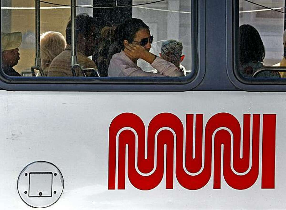 MUNI passengers ride the light rail system on Duboce Street at Church in San Francisco Tuesday August 4, 2009