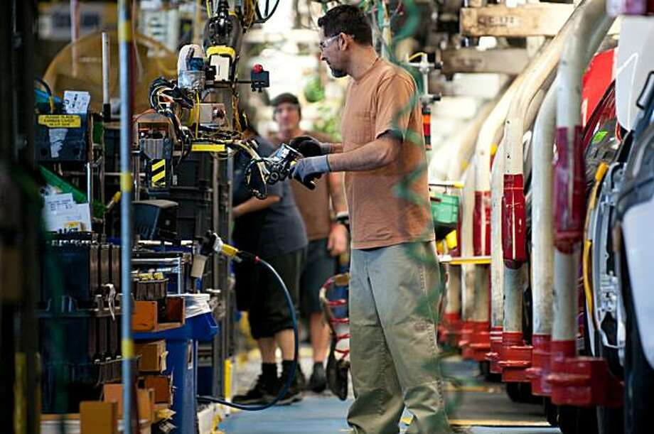 Workers at the NUMMI plant in Fremont, CA, man their posts on the assembly line of new Toyota Corollas on March 4, 2010. Photo: Chad Ziemendorf, Special To The Chronicle