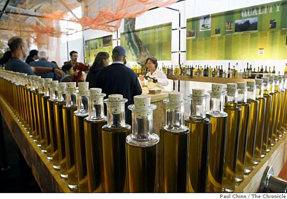 Food lovers slide up to the olive oil tasting bar. Photo: Paul Chinn, The Chronicle