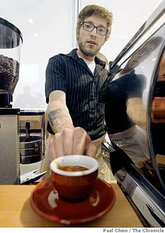 Jared Linzmeier serves up a fresh espresso at the Slow Food Nation event at Fort Mason. Photo: Paul Chinn, The Chronicle