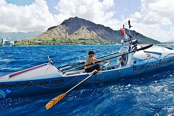 Roz Savage rows past the volcano crater Diamond Head on her way into Waikiki Harbor, 99 days after setting off from San Francisco in what is a quest to become the first woman to row solo across the Pacific Ocean