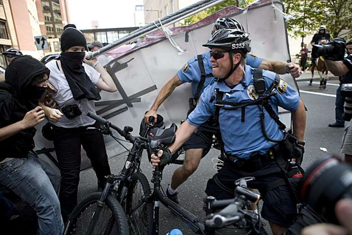 ST. PAUL, MN - SEPTEMBER 1: Protestors clash with police outside the Republican National Convention (RNC) at the Xcel Energy Center September 1, 2008 in St. Paul, Minnesota. The RNC began today and runs through September 4. (Photo by Max Whittaker/Getty Images)