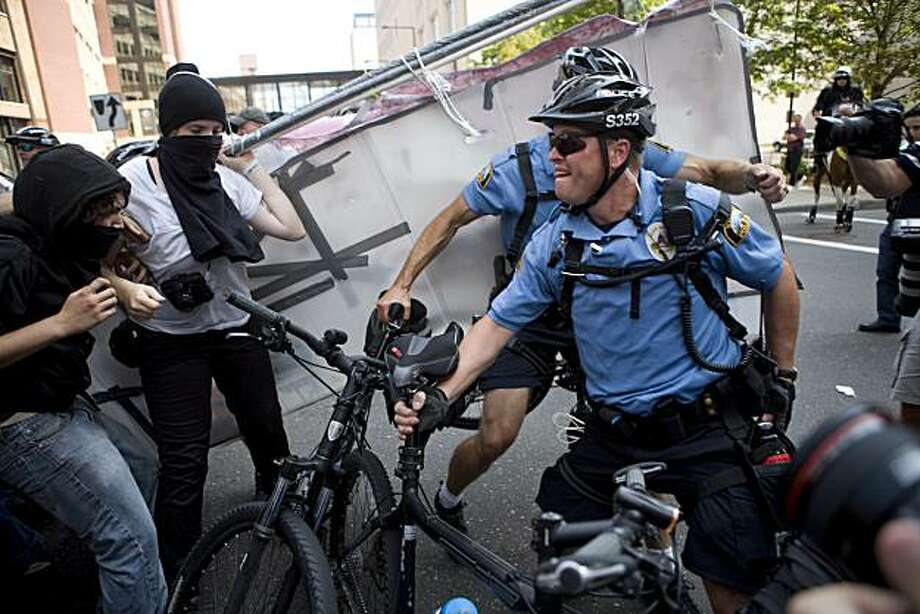 ST. PAUL, MN - SEPTEMBER 1:  Protestors clash with police outside the Republican National Convention (RNC) at the Xcel Energy Center September 1, 2008 in St. Paul, Minnesota. The RNC began today and runs through September 4.  (Photo by Max Whittaker/Getty Images) Photo: Max Whittaker, Getty Images