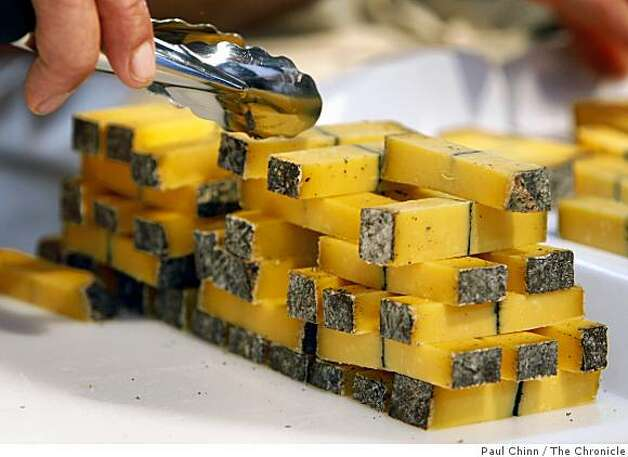 Small blocks of cheese are served to food lovers at the Slow Food Nation event on Saturday. Photo: Paul Chinn, The Chronicle