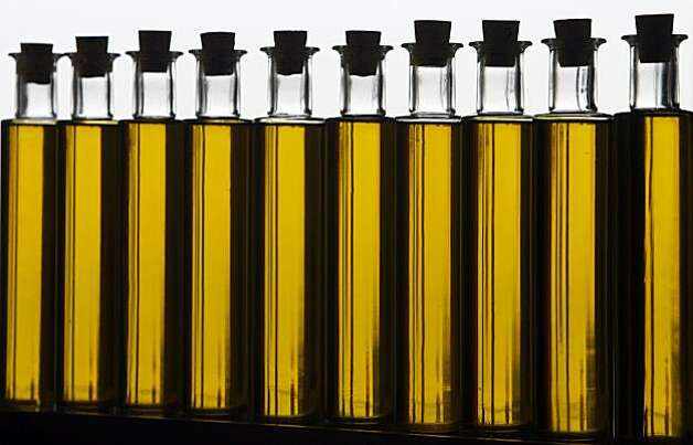 Bottles of olive oil are lined up inside the Taste Pavilions of the Slow Food Nation event at Fort Mason. Photo: Paul Chinn, The Chronicle