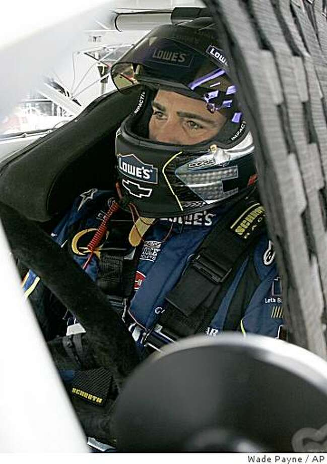 ** FILE ** In this Friday, Aug. 22, 2008, file photo, Jimmie Johnson sits in his car during practice for the NASCAR Sprint Cup Series Sharpie 500 auto race at Bristol Motor Speedway in Bristol, Tenn. While Johnson and superstar teammates Jeff Gordon and Dale Earnhardt Jr. are all likely to make the Chase for the championship, all three have spent most of the season chasing series leader Kyle Busch and red-hot Carl Edwards. (AP Photo/Wade Payne, File) Photo: Wade Payne, AP
