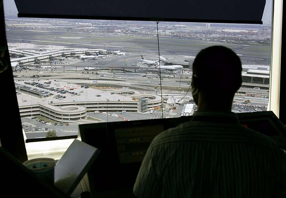 **FILE** In this June 30, 2008, a controller watches over air traffic from the control tower at Newark Liberty International Airport in Newark, N.J. When a computer glitch at a Federal Aviation Administration center caused widespread airline delays this week, the agency and some of its critics called it a reminder of the importance of a pending modernization of the nation's flight system. (AP Photo/Mel Evans) Photo: Mel Evans, AP