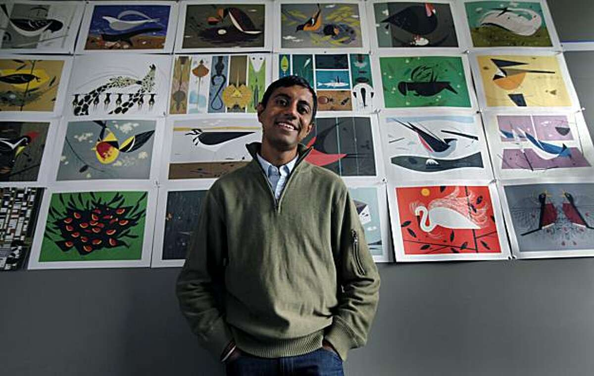 Pixar animator Sanjay Patel stands in front of a panel of prints that inspire him in his Emeryville Ca, office by the late Charley Harper. Patel is now author, having just published his new book titled the Ramayana, a Hindu epic. Tuesday March. 2, 2010