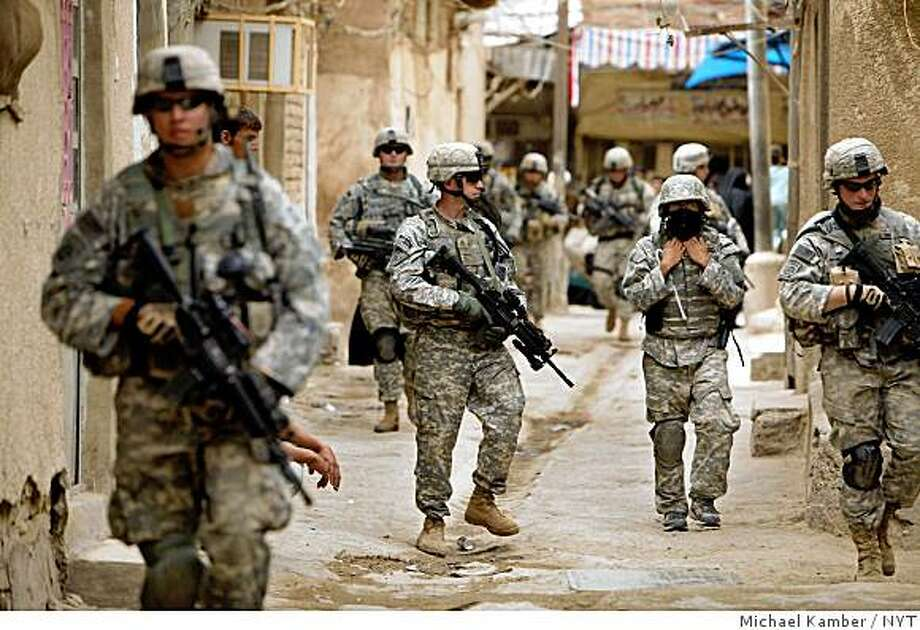 """*FILE PHOTO*(NYT38) BAGHDAD, Iraq -- August 30, 2008 -- IRAQ-SURGE -- American soldiers conducting a patrol in the Kadhimiya neighborhood of Baghdad in April 2007. When President Bush speaks to the Republican convention on Monday, he is expected to tout the """"surge"""" of forces in Iraq as one of his proudest achievements. But that decision, one of his most consequential as commander in chief, came only after months of tumultuous debate within the administration, according to still-secret memorandums and interviews with a broad range of current and former officials. (Michael Kamber/The New York Times) Photo: Michael Kamber, NYT"""